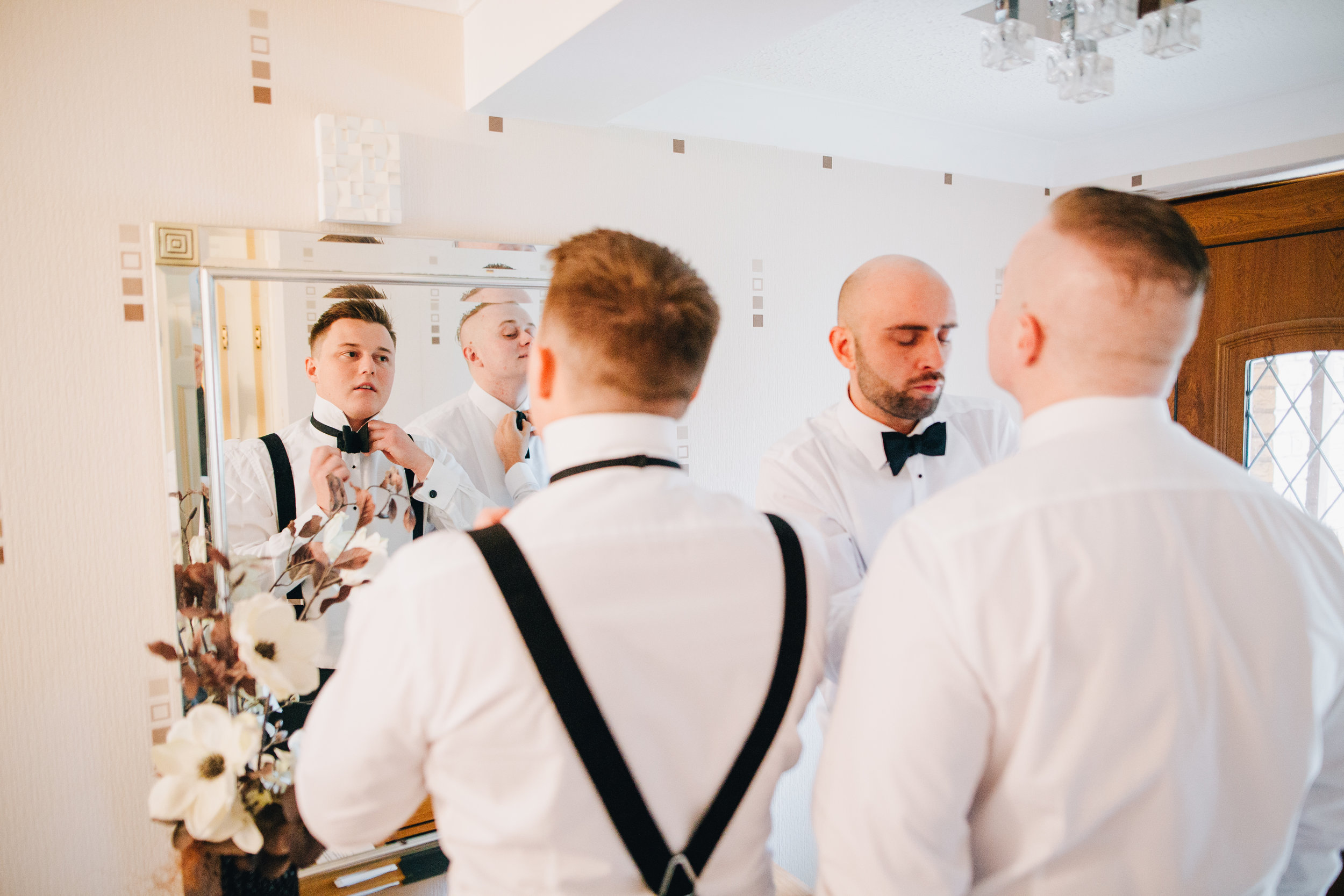groom prep at Eaves Hall wedding