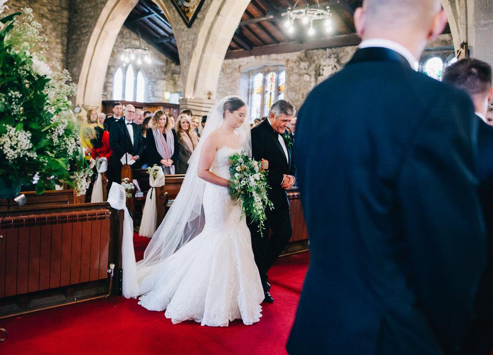 bride walking down the aisle - wedding photographer in lancashire