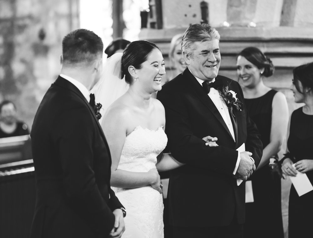 bride and her father laughing during wedding ceremony in lancashire