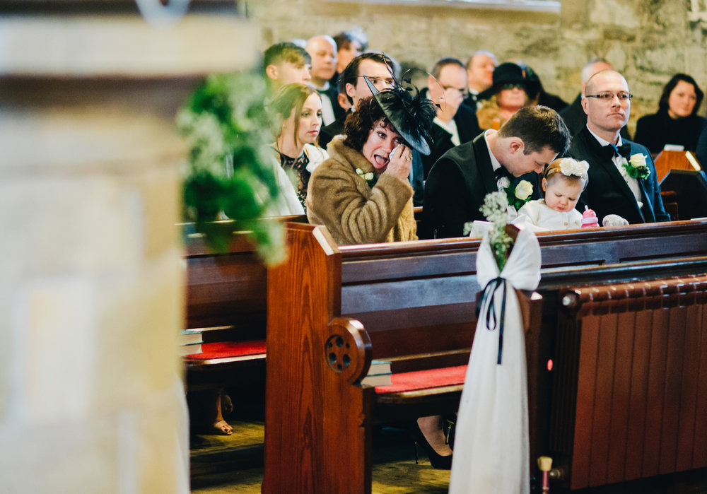 mum gets emotional during the wedding ceremony in lancashire