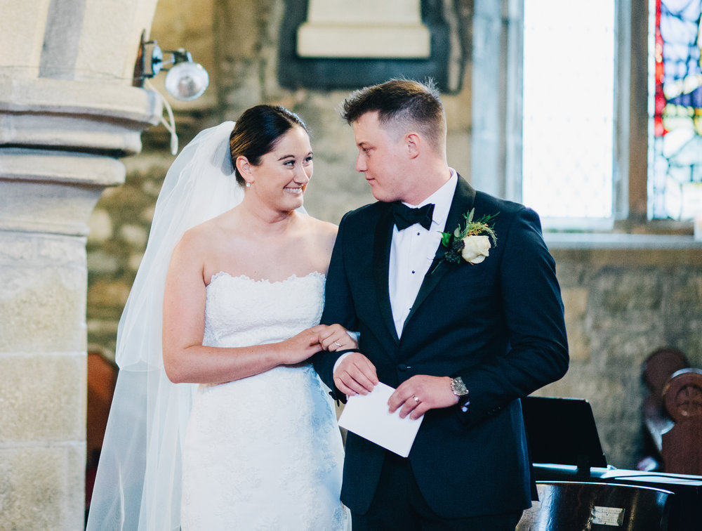 bride and groom share a look with each other