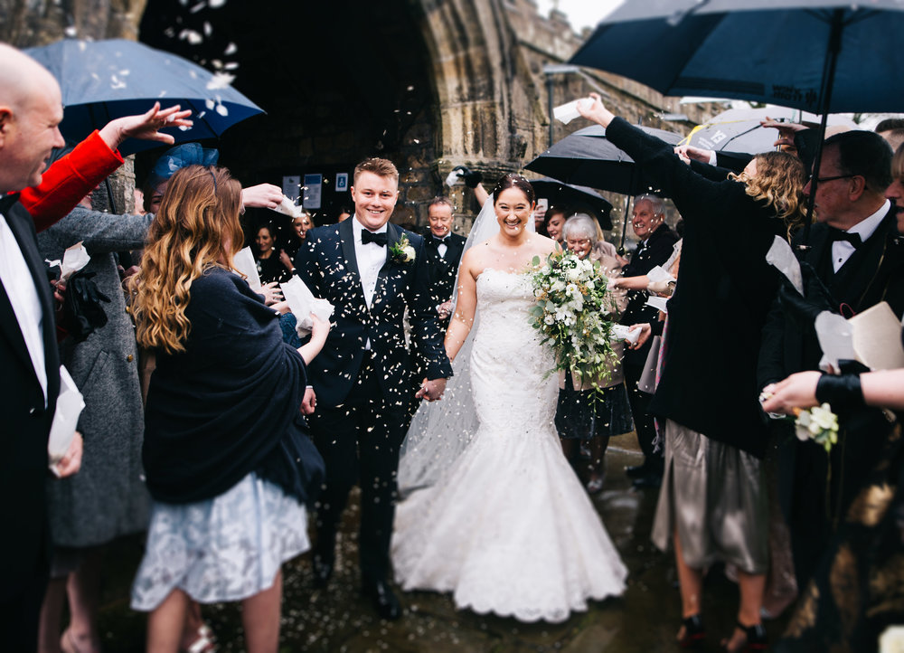 fun and creative wedding images - bride and groom walk through confetti