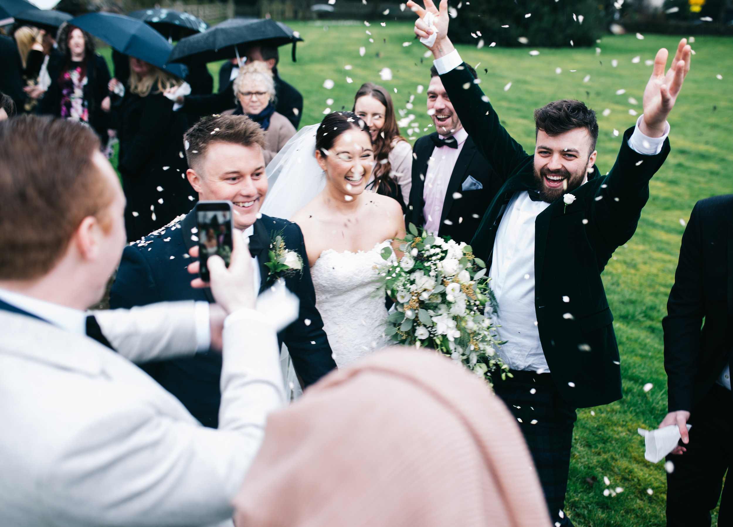 enthusiastic guests at confetti throw - lancashire wedding photographer