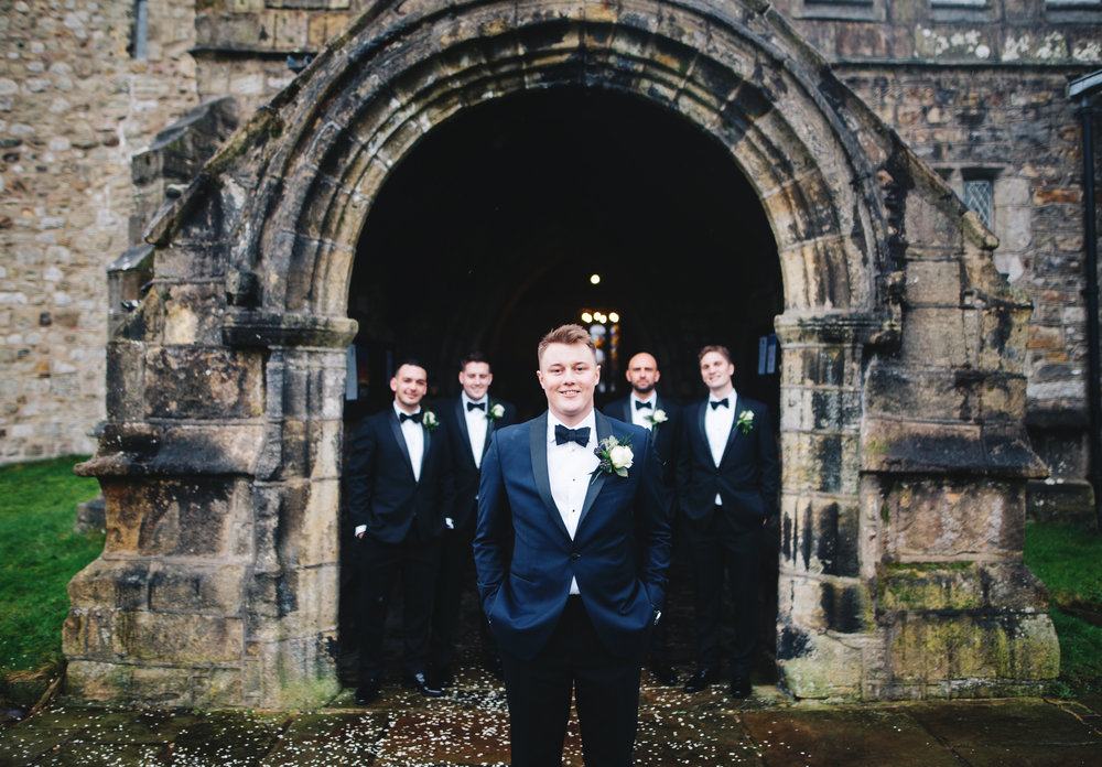 groom and groomsmen outside church in lancashire