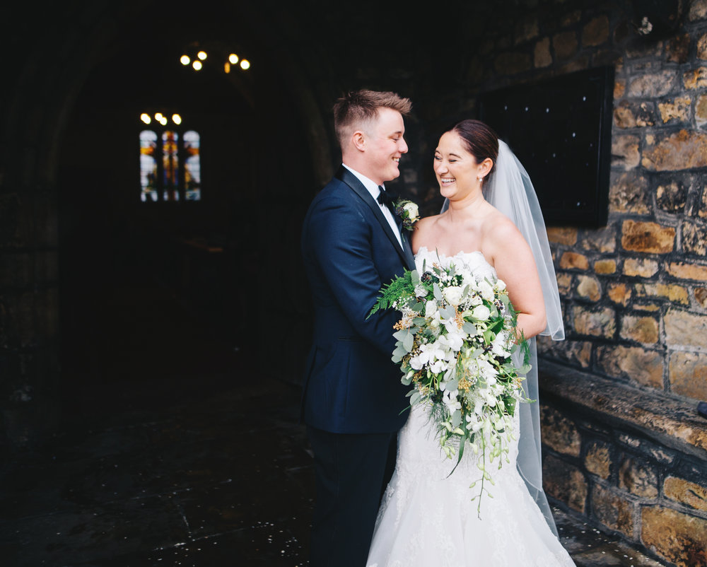 portrait of bride and groom outside the church in lancashire