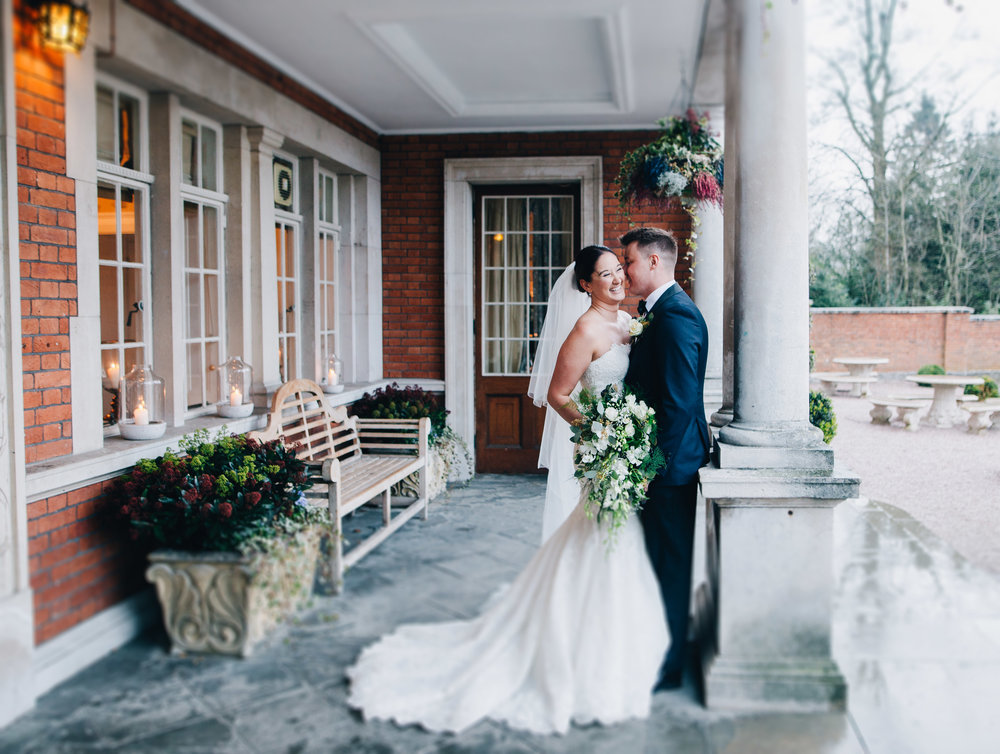 bride and groom outside Eaves Hall - relaxed wedding photography