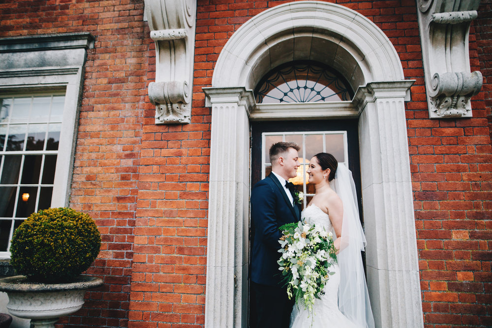 modern and relaxed wedding portraits in Lancashire  - bride and groom outside Eaves Hall