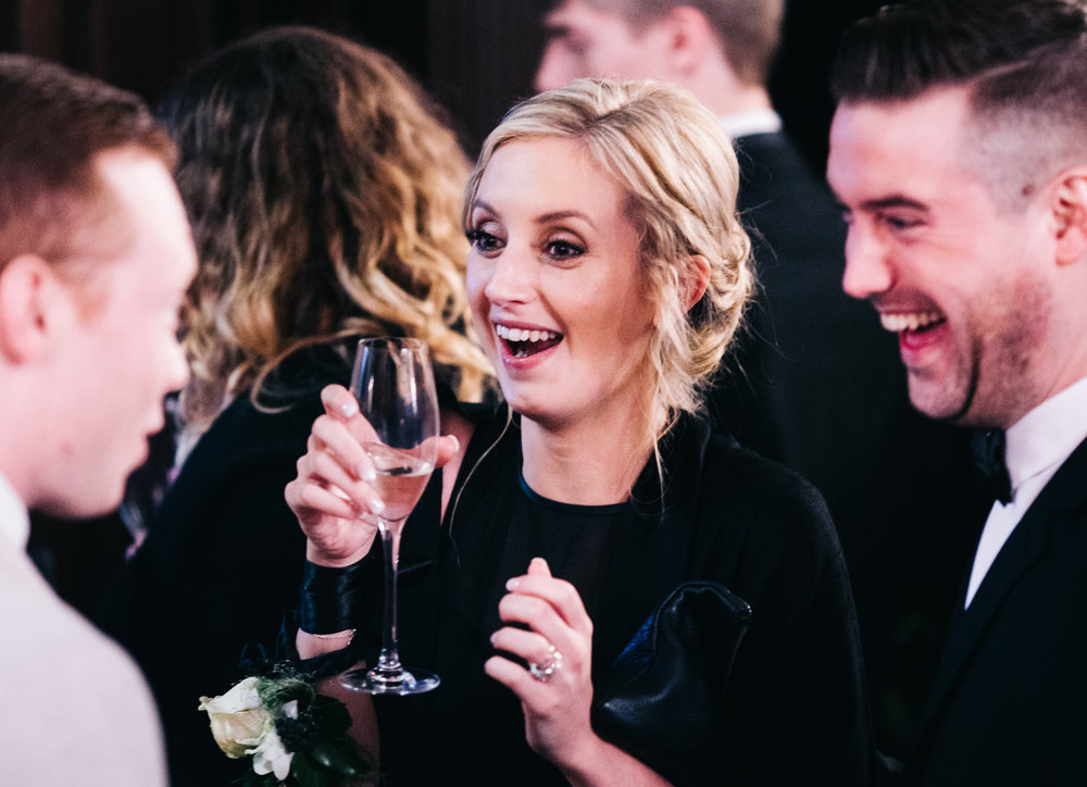 guests laughing - eaves hall wedding photographs