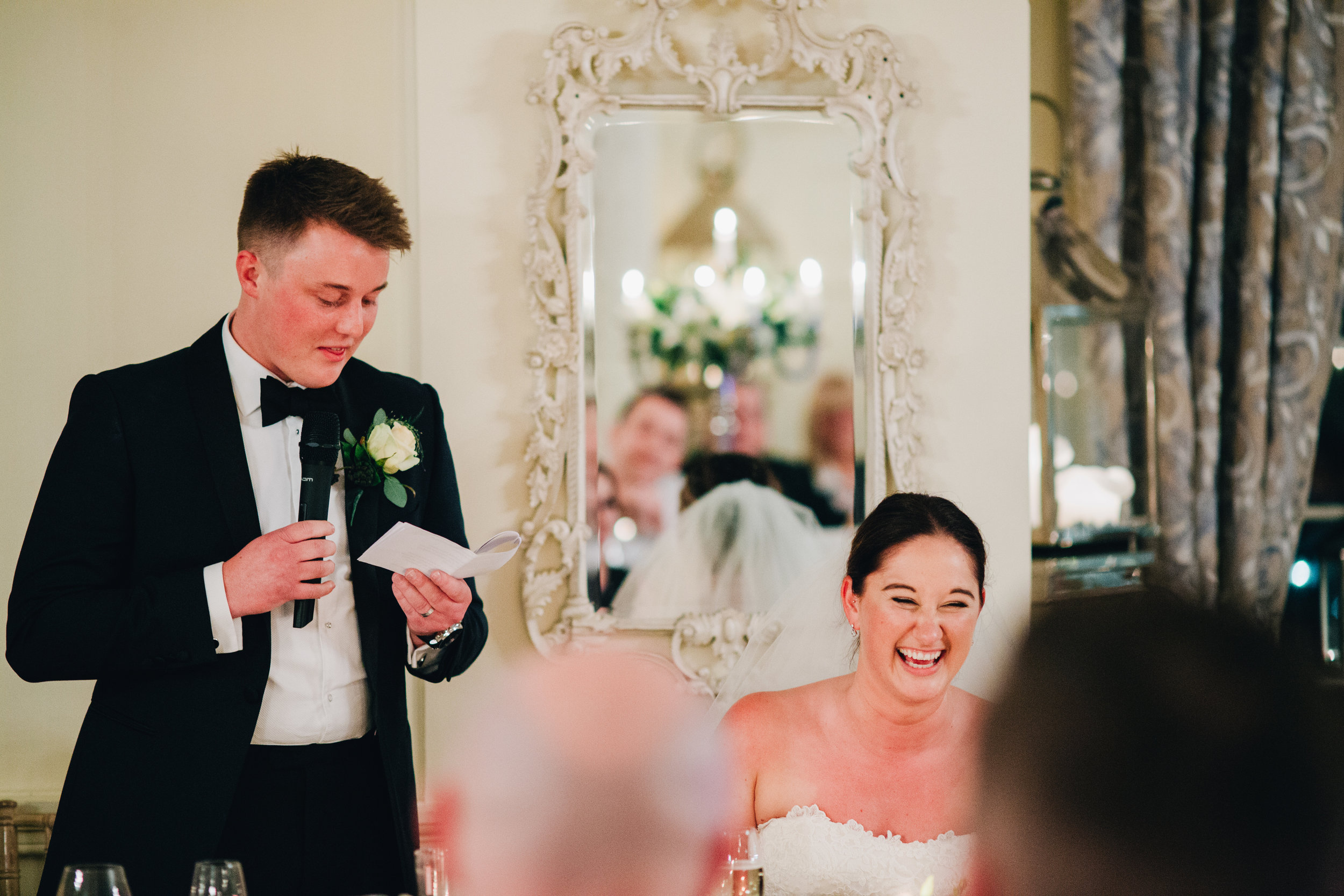 bride laughing speeches at Eaves Hall