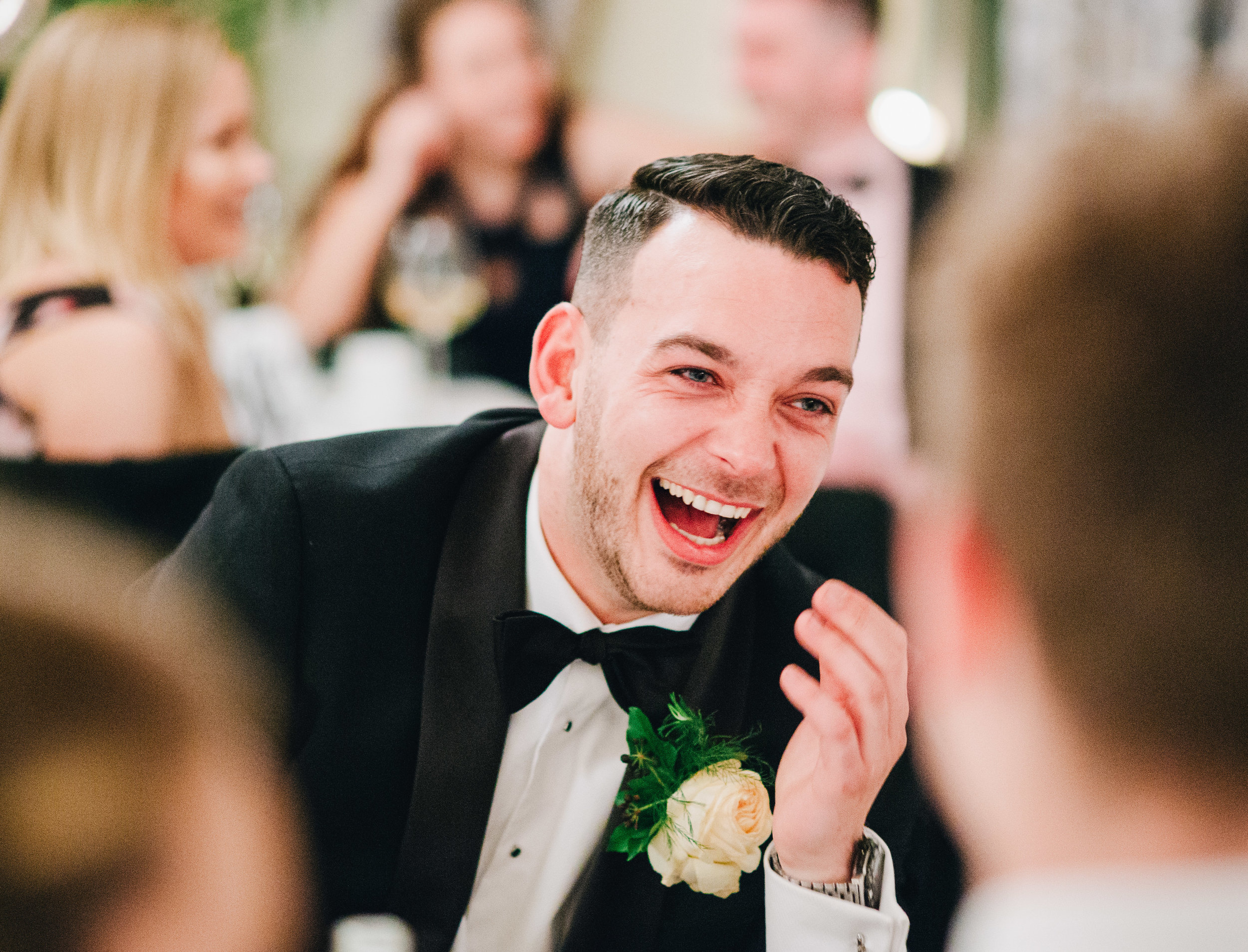 Guests laugh during speeches - natural wedding photography