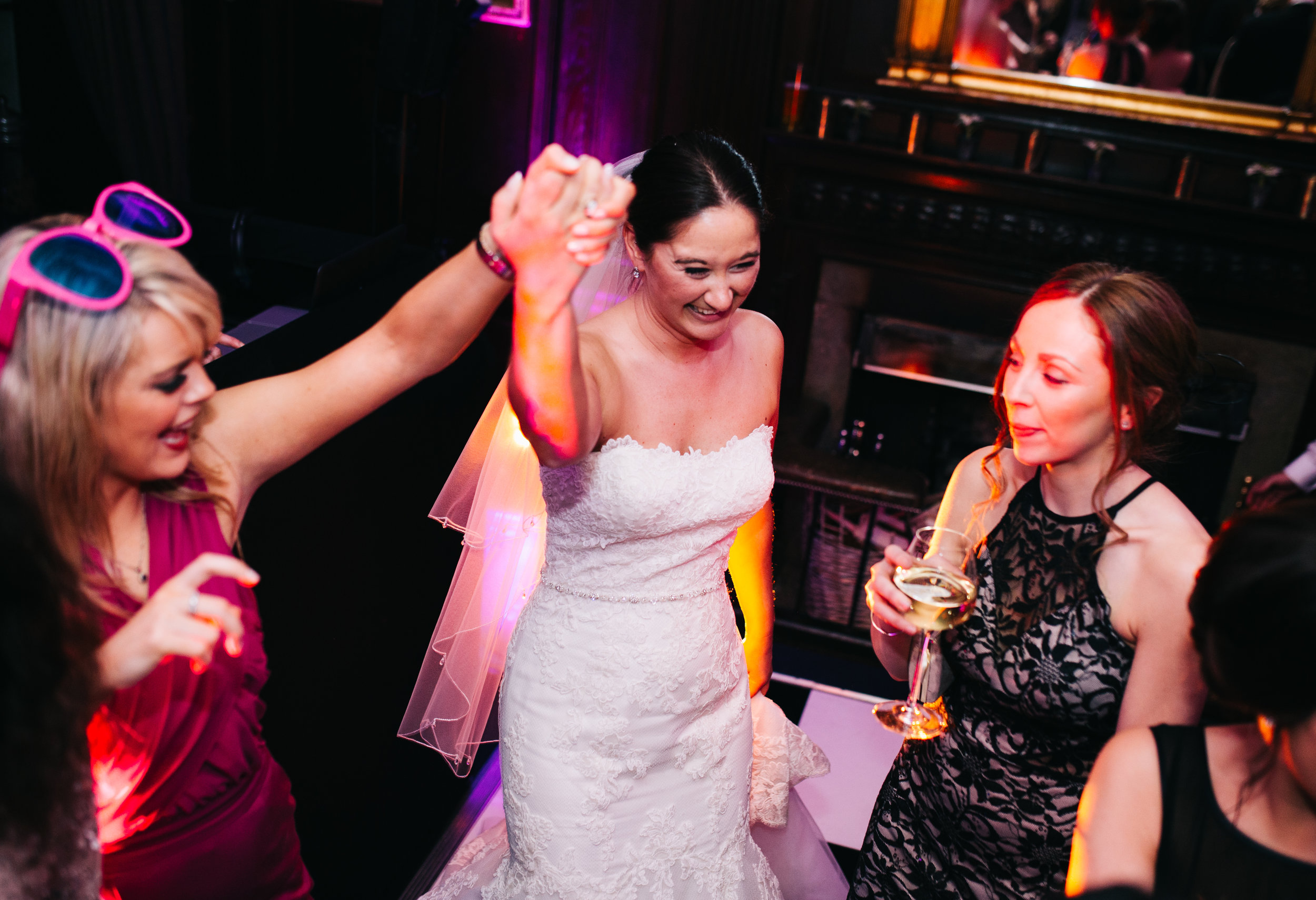 Bride dancing with friends - CLitheroe wedding photographer