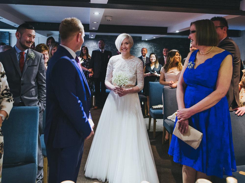 bride walks down the aisle - manchester wedding photographer