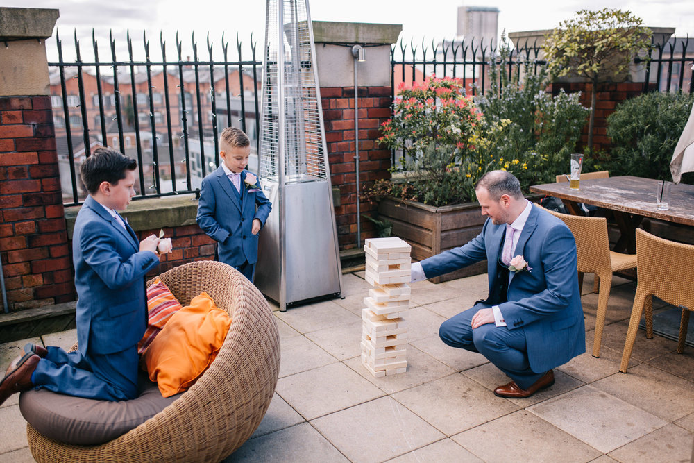 groom plays games with guests