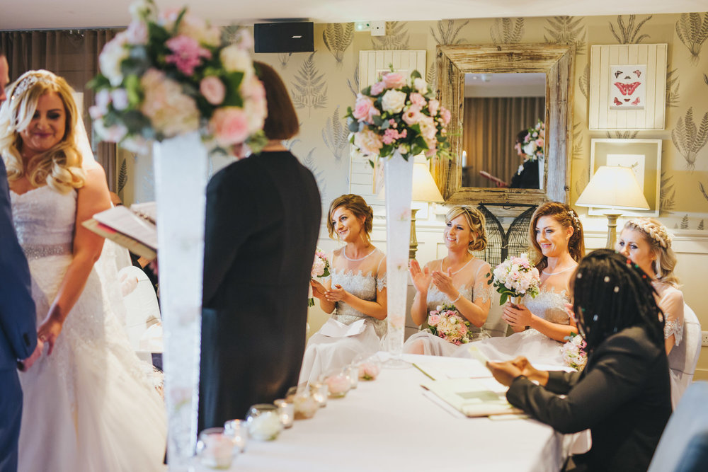 bridesmaid claps during wedding ceremony in Manchester