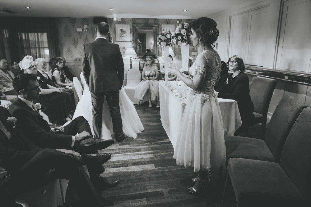 bridesmaid gives a reading at great John street wedding