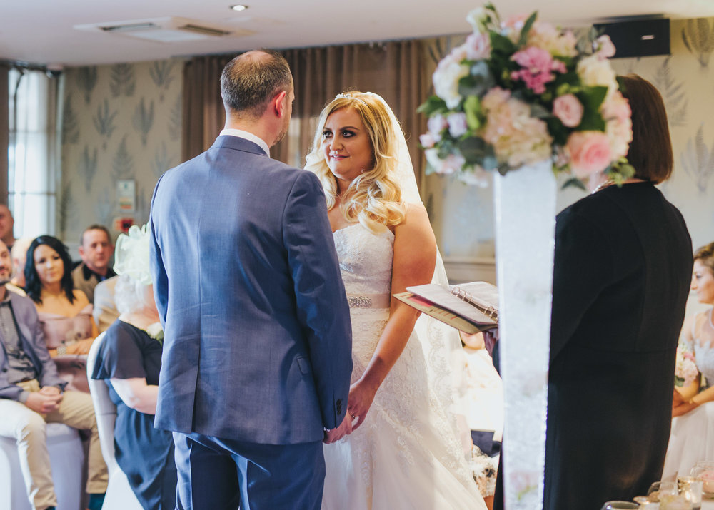 bride and groom exchanging vows - wedding photographer in Manchester
