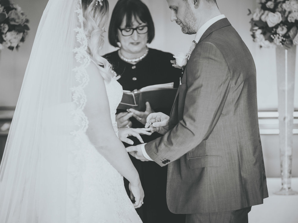 exchanging the rings at great John street hotel wedding