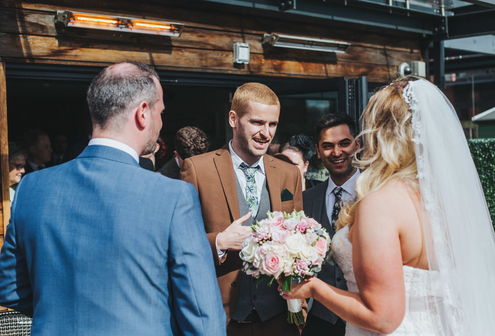 natural and relaxed wedding photography in Manchester. guests laughing