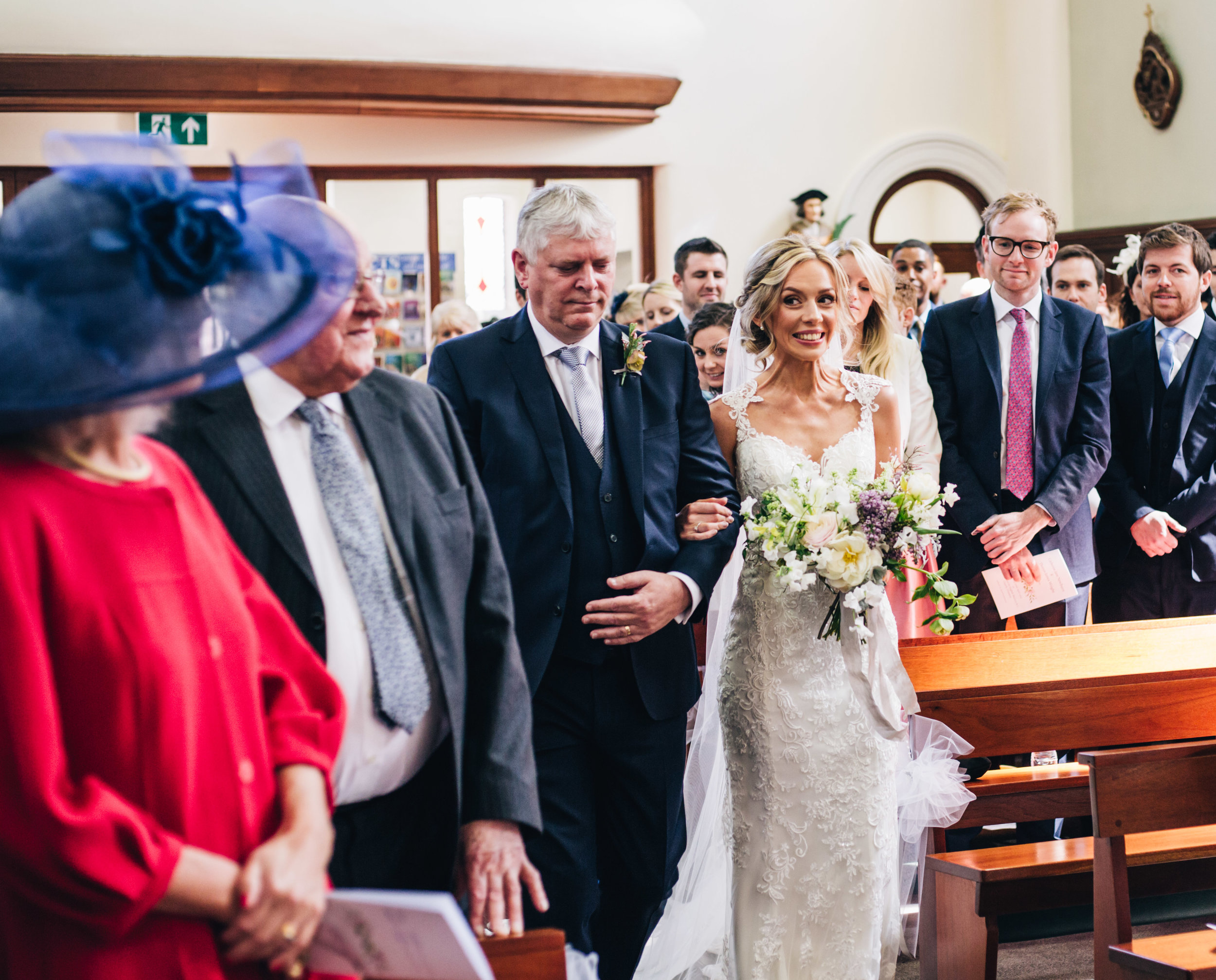 excited bride walks down the aisle - wedding photography Cheshire