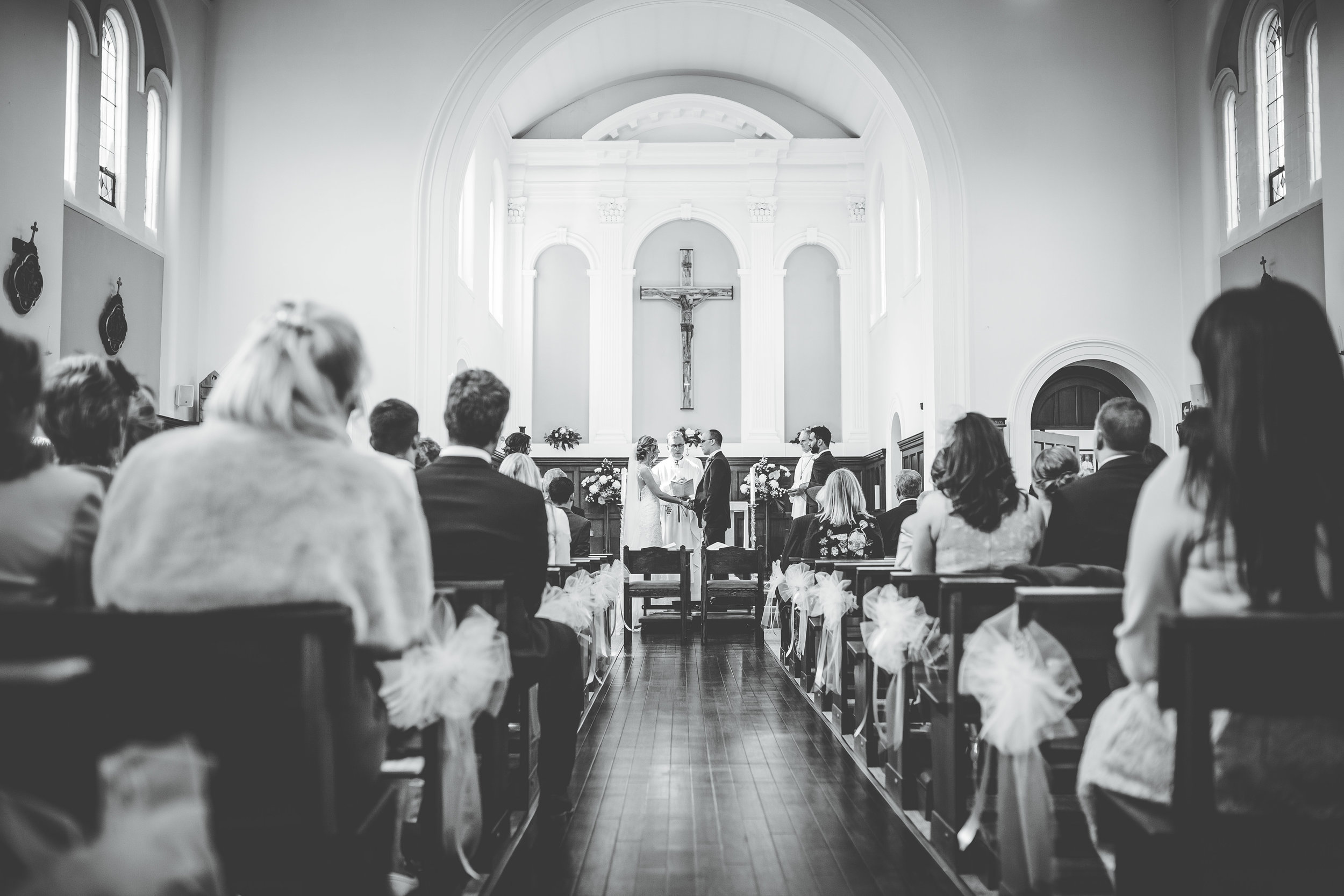 black and white wedding photography - bride and groom at ceremony