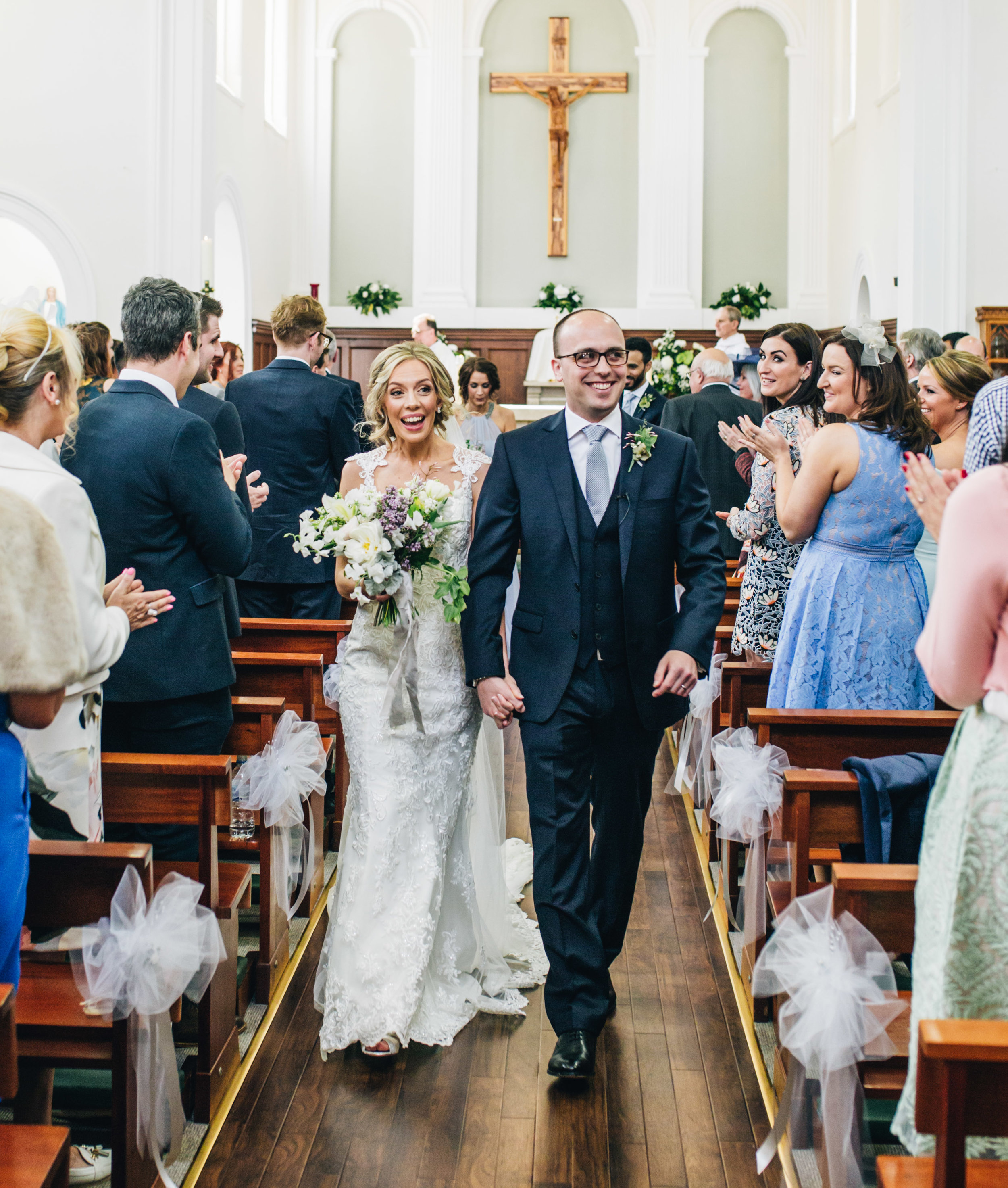 Cheshire wedding photography - leaving church as newlyweds
