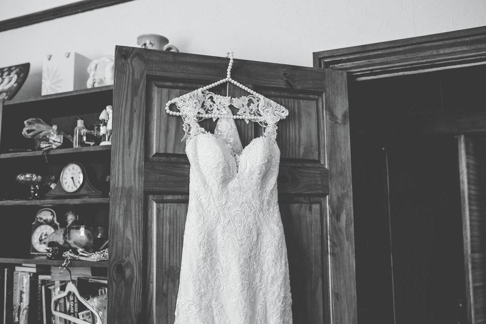 cheshire wedding photographer - bride's wedding dress hanging up