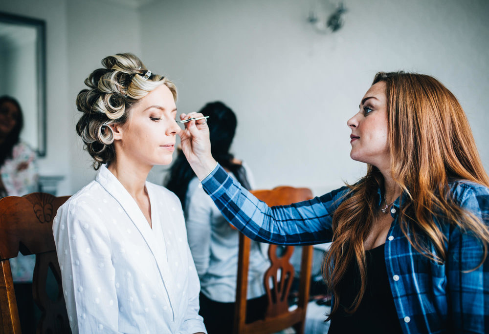 bride having her make up done - wedding photography in cheshire