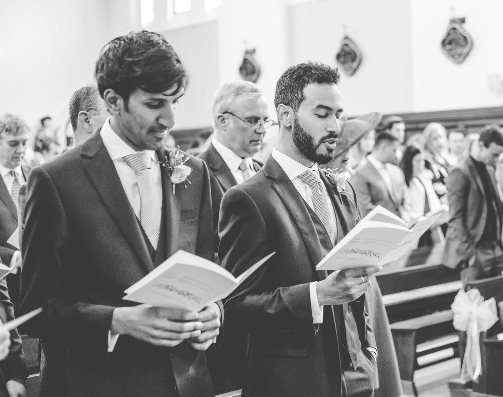 groomsmen singing in church