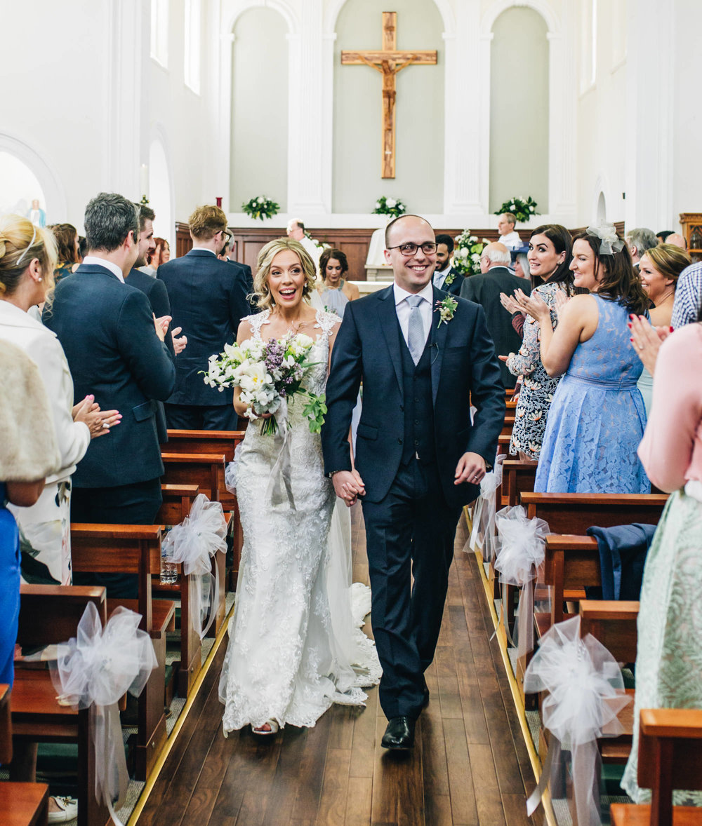 walking out of church as a married couple - documentary wedding photographer cheshire
