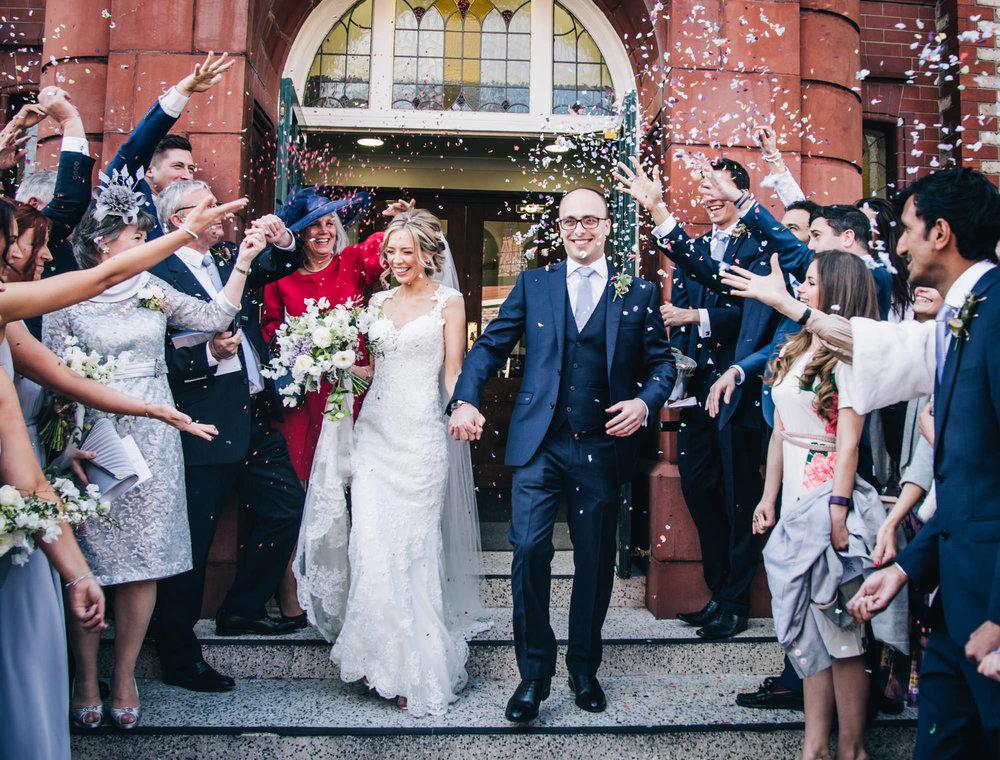 walking through the confetti - cheshire wedding photographer