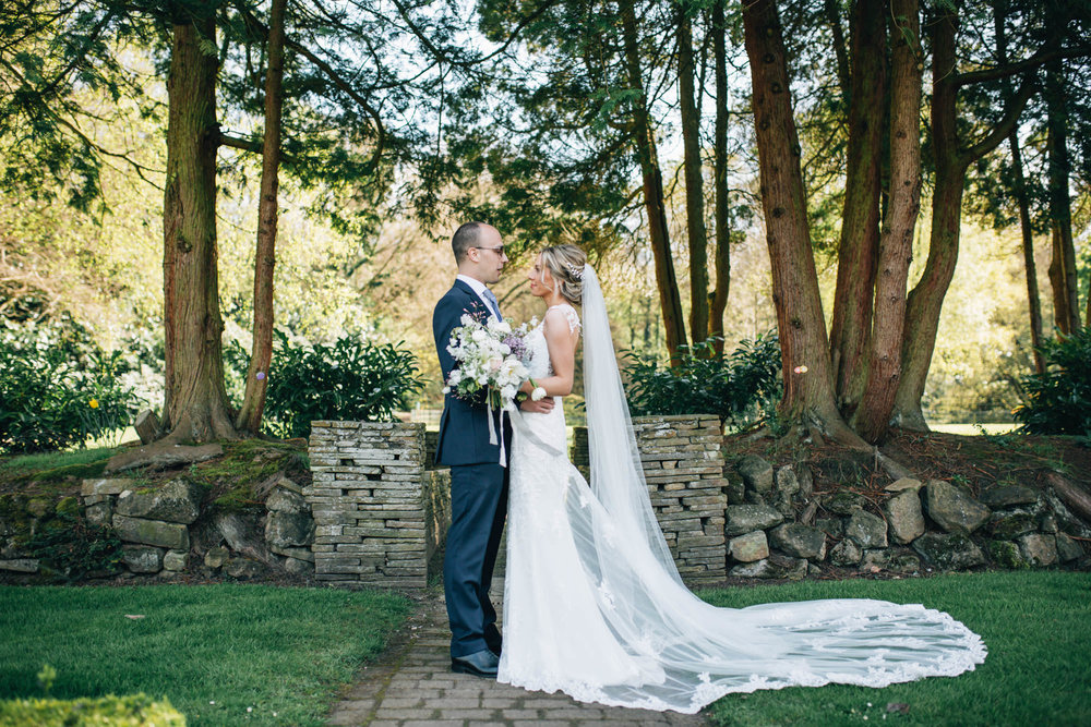 bride and groom at Mottram Hall in Cheshire - portraits in the grounds