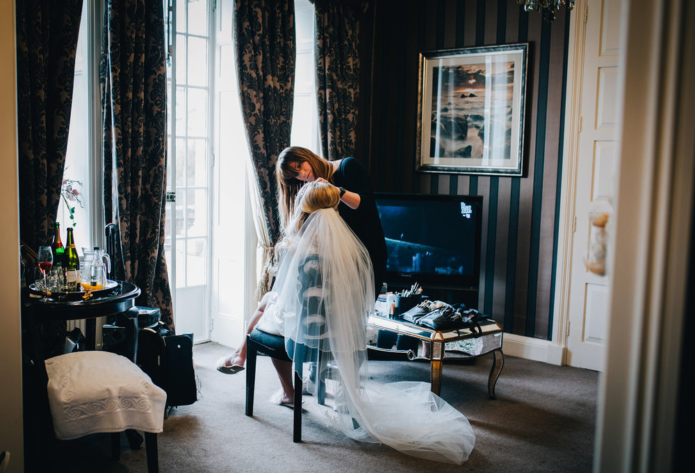 bride having her makeup done - rubble valley wedding photographer