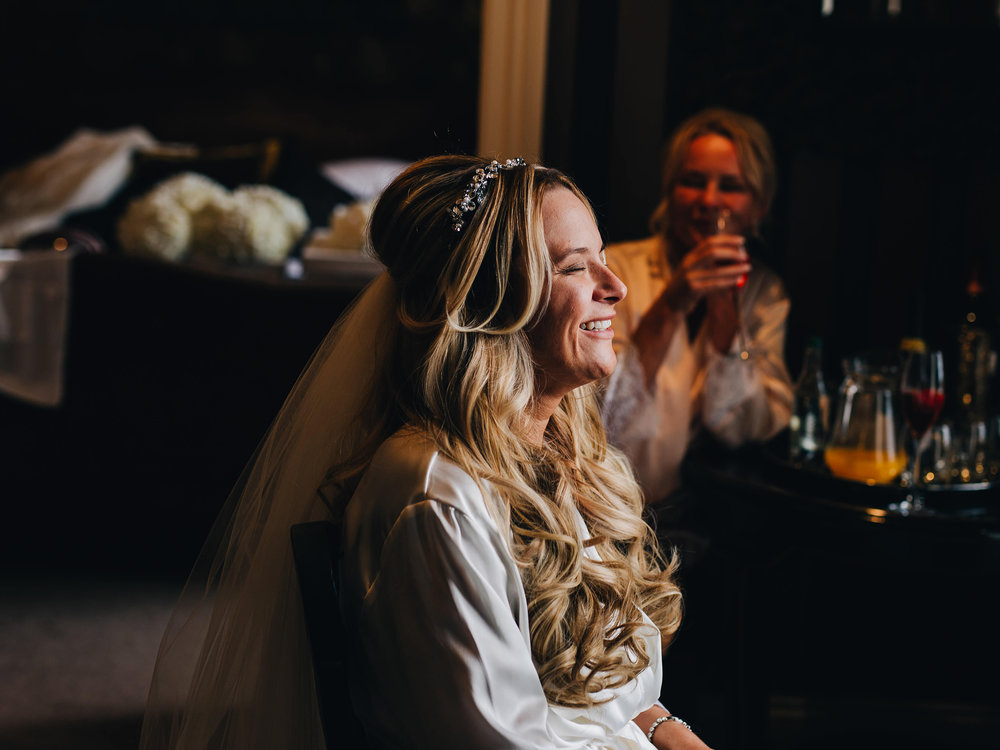 bride laughing -relaxed wedding photography