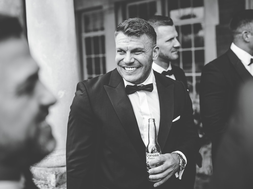 laughing groomsman - Ribble Valley wedding photography