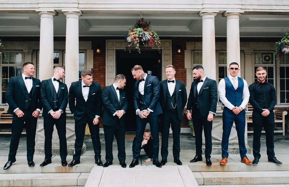 group shot of groomsmen - fun and relaxed wedding photography