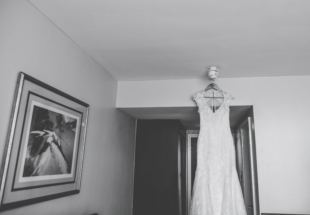 bride's dress hanging up at the hotel - hyde bank farm wedding