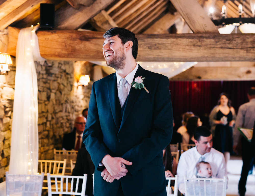 groom laughs as guests arrive at hyde bank farm