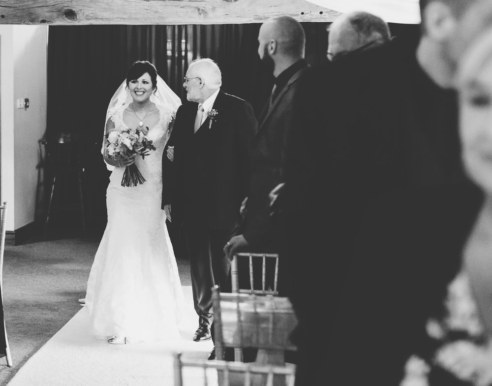 bride walks down the aisle with her dad - manchester wedding photographer