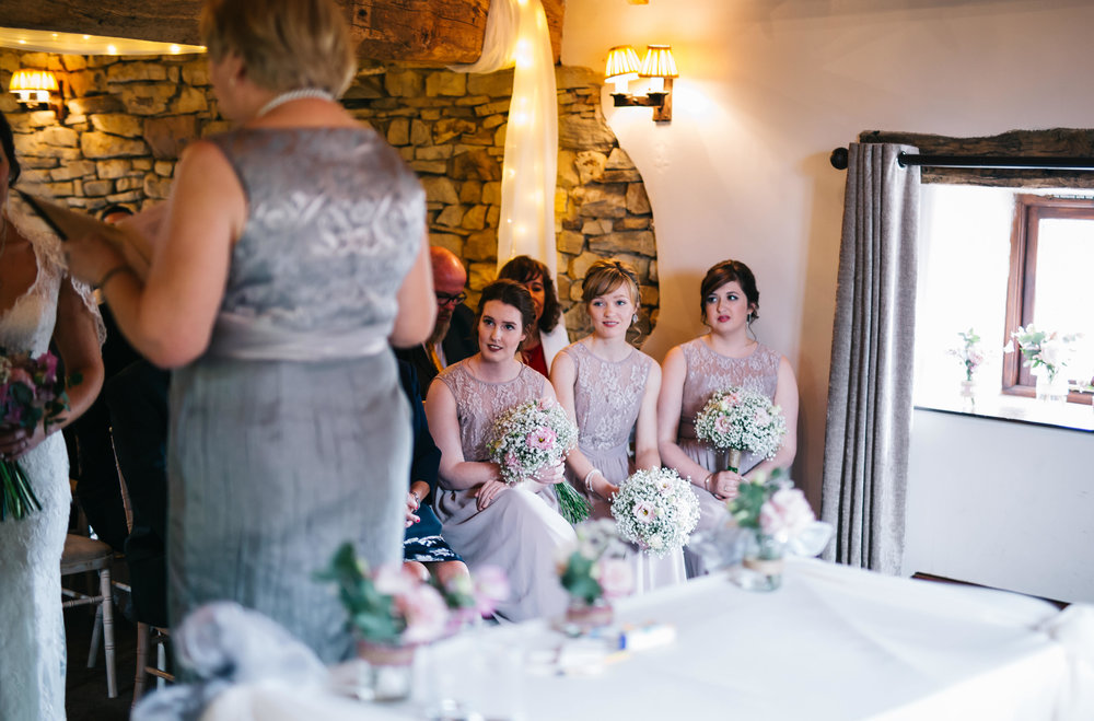 bridesmaids get emotional during the wedding ceremony