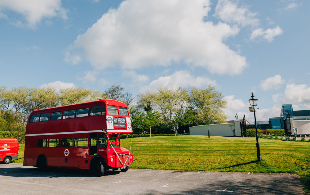 Red double bus for the wedding guests, Lancashire Documentary photography, Rustic wedding.