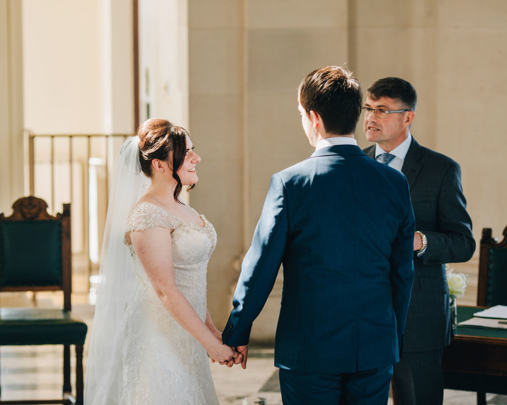 Bride and groom stood hand in hand at the Ashton Memorial, Creative Lancashire photography.