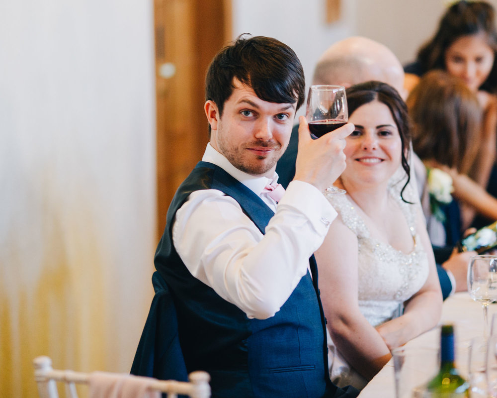 Cheers from the groom, Documentary styled photography, Ashton Memorial wedding day venue.