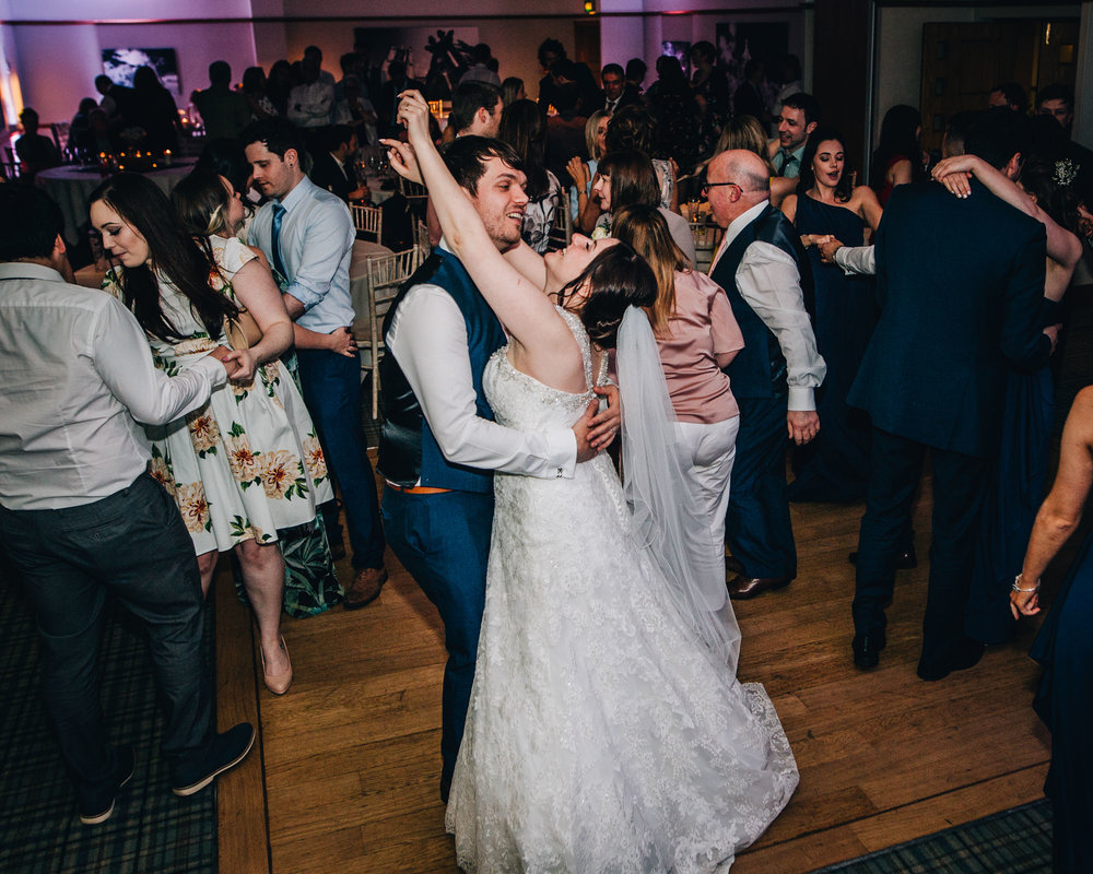 Bride and groom dancing on the dance floor, Rustic themed wedding at Ashton memorial.