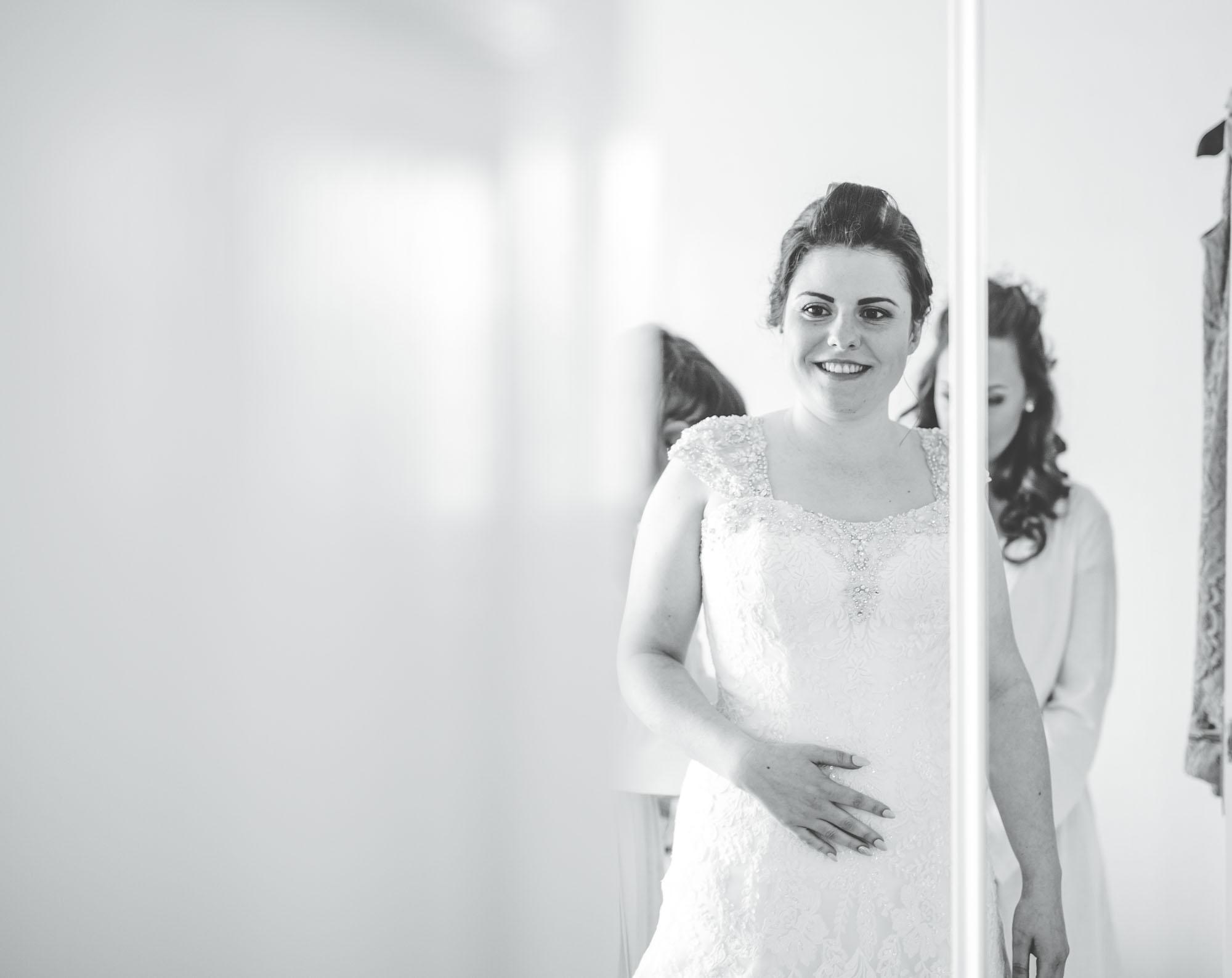 bride getting dressed - wedding photography Lancashire