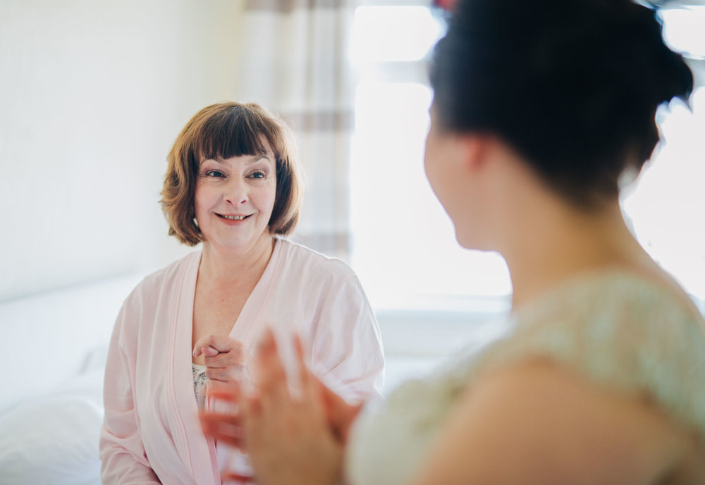 Mother of the bride looking at her daughter, Creative wedding photography, Lancashire wedding, Vintage wedding.