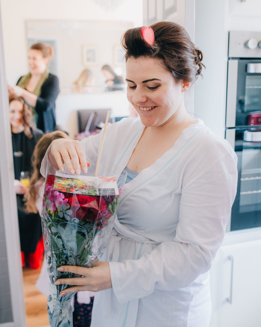 Bride looking at flowers, Documentary wedding photography, Vintage wedding at Ashton Memorial.