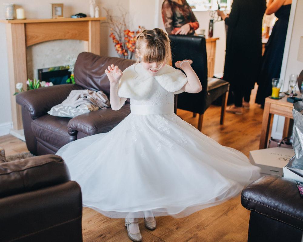 Little flower girl spinning in her dress, Rustic vintage wedding at Ashton Memorial, Creative wedding photographer.