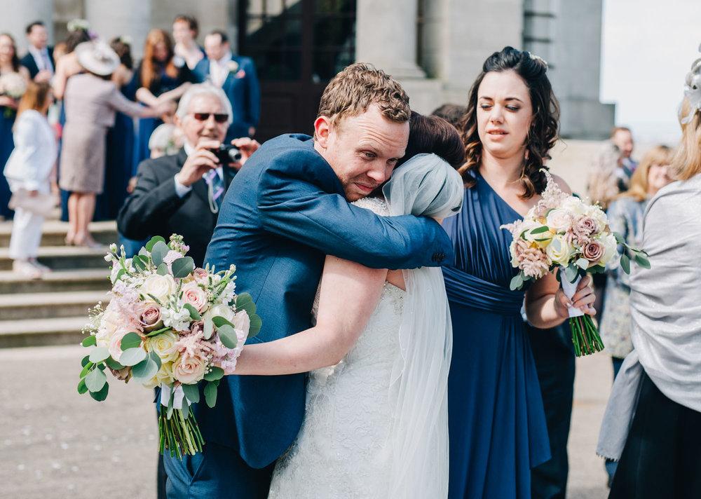 Bride hugging wedding guest, Ashton Memorial wedding, Lancaster wedding day, Rustic wedding.