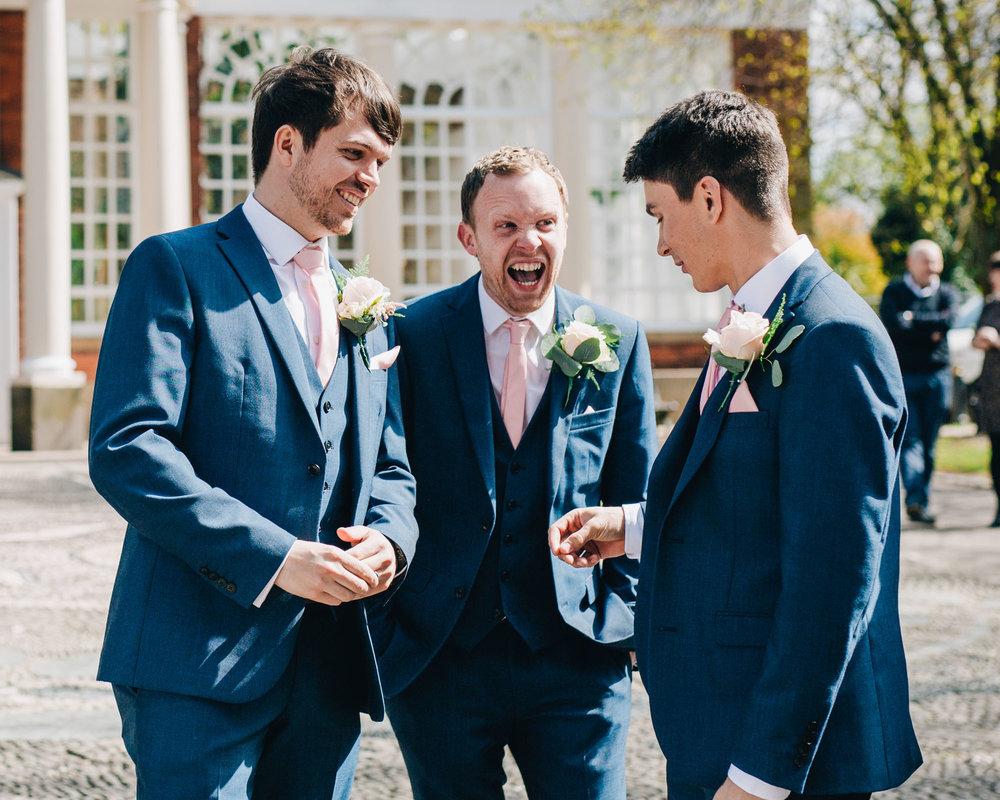 Groom and best men outside the Ashton Memorial Lancaster, Creative wedding photography.