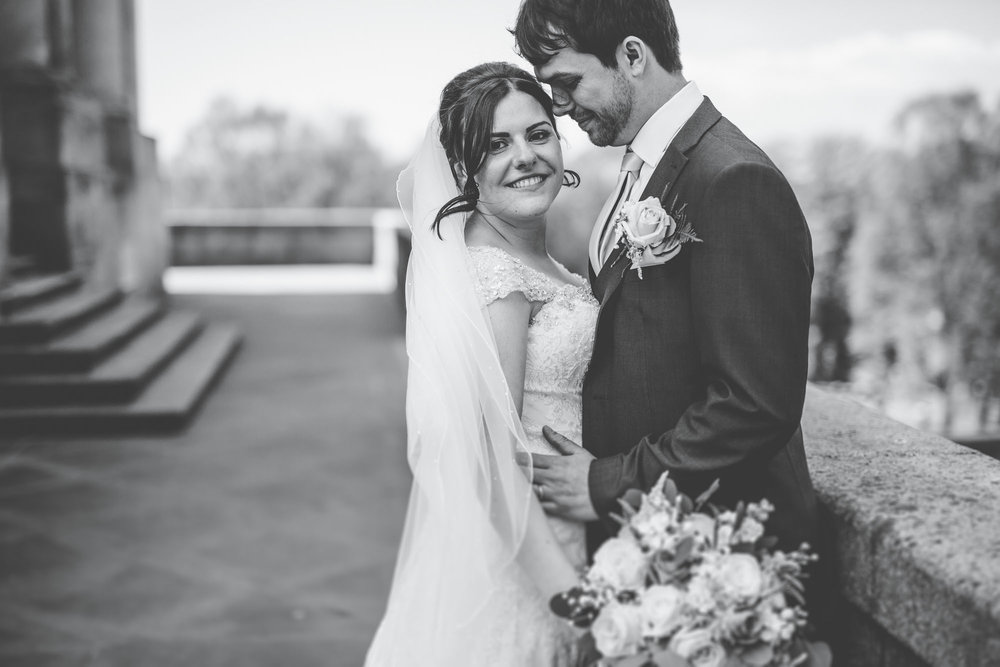 Black and white photograph of the bride and groom outside Ashton Memorial, Rustic styled wedding in Lancaster.